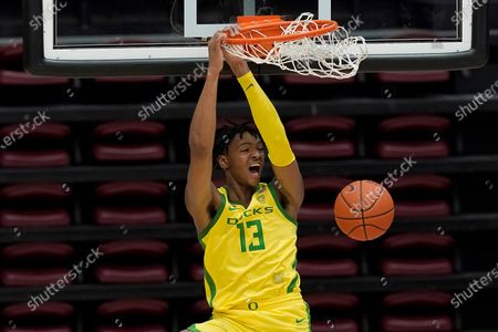 Oregon forward Chandler Lawson dunks against Stanford during the second half of an NCAA college basketball game in Stanford, Calif