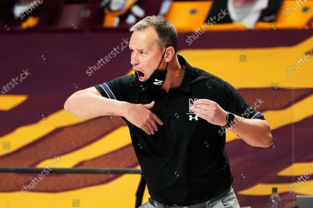 Northwestern head coach Chris Collins directs his players in the second half of an NCAA college basketball game against Minnesota, in Minneapolis