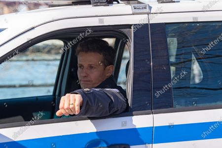 """Stock Photo of Will Estes is seen on a film production trailer during the filming of the television show """"Blue Bloods"""" season eleven in Astoria Park in New York City."""