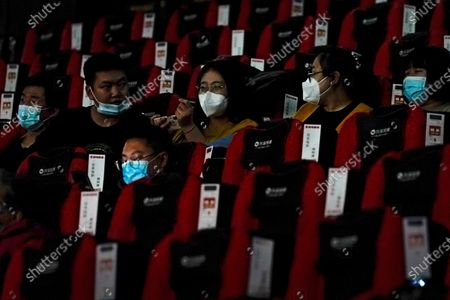 Stock Picture of People wearing face masks to help curb the spread of the coronavirus chat each other as the watch a film at Poly Cinema in Beijing on . With coronavirus well under control in China and cinemas running at half capacity, moviegoers are smashing China's box office records, setting a new high mark for ticket sales in February, with domestic productions far outpacing their Hollywood competitors