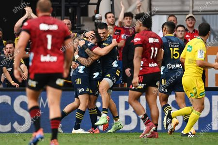 Highlanders vs Crusaders. Highlanders' Connor Garden-Bachop celebrates scoring a try with Ngatungane Punivai and Aaron Smith