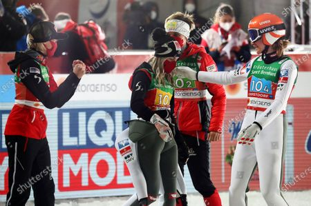 From left, Austria's Daniela Iraschko-Stolz, Chiara Hoelzl, Sophie Sorschag and Marita Kramer celebrate during the women's ski jumping normal hill team competition at the FIS Nordic World Ski Championships in Oberstdorf, Germany