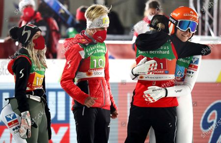 Stock Photo of From left, Austria's Chiara Hoelzl, Sophie Sorschag, Daniela Iraschko-Stolz and Marita Kramer celebrate winning the gold medal during the women's ski jumping normal hill team competition at the FIS Nordic World Ski Championships in Oberstdorf, Germany