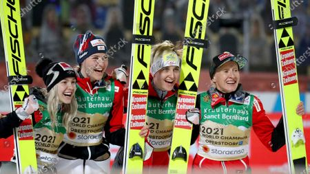Stock Picture of From left, Austria's gold medalists Chiara Hoelzl, Marita Kramer, Sophie Sorschag and Daniela Iraschko-Stolz celebrate after the women's ski jumping normal hill team competition at the FIS Nordic World Ski Championships in Oberstdorf, Germany