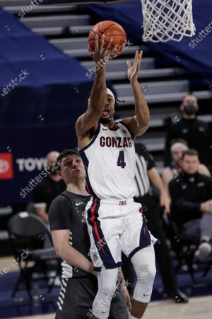 Gonzaga guard Aaron Cook, right, shoots in front of Santa Clara guard Miguel Tomley during the second half of an NCAA college basketball game in Spokane, Wash