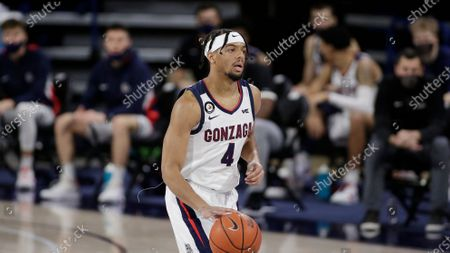 Gonzaga guard Aaron Cook brings the ball up the court during the first half of an NCAA college basketball game against Santa Clara in Spokane, Wash