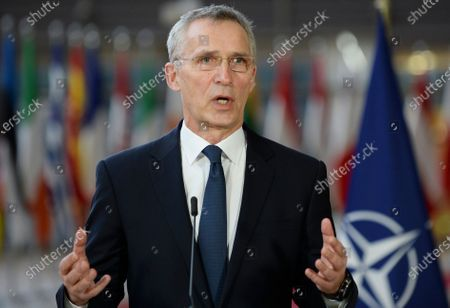 Secretary General Jens Stoltenberg speaks with the media ahead of an EU summit video conference on security and defense issues at the European Council building in Brussels, . NATO Secretary General Jens Stoltenberg and European Council President Charles Michel are taking part in a videoconference with EU leaders on Friday, focused on ways to boost cooperation and avoid doubling up on security issues between the military alliance and the 27-nation bloc
