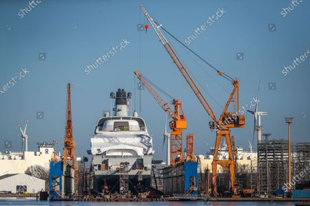 A new built mega yacht sits in a floating dock at the Lloyd-Werft shipyards in Bremerhaven, northern Germany, 26 February 2021. According to a report of German float Magazin, the 140 meters long ship is the Solaris, an expedition yacht owned by Russian billionaire Roman Abramovich. As the Llyod shipyards could be closed in the near future due to financial problems, the ship might be its last mega yacht.