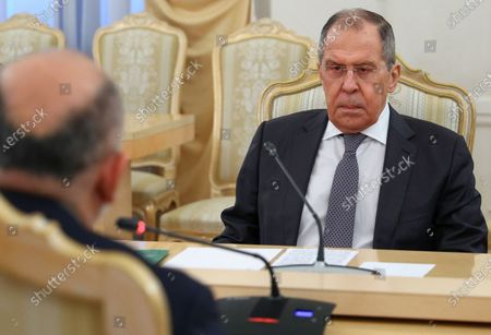 Russian Foreign Minister Sergei Lavrov (R) listens Afghanistan's Foreign Minister Mohammad Hanif Atmar (L) during their meeting in Moscow, Russia, 26 February 2021.