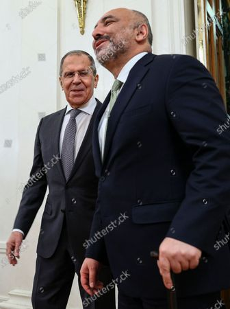 Russian Foreign Minister Sergei Lavrov (L) enters a hall with Afghanistan's Foreign Minister Mohammad Hanif Atmar (R) during their meeting in Moscow, Russia, 26 February 2021.