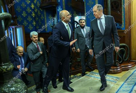 Russian Foreign Minister Sergei Lavrov (R) welcomes Afghanistan's Foreign Minister Mohammad Hanif Atmar (C) during their meeting in Moscow, Russia, 26 February 2021.