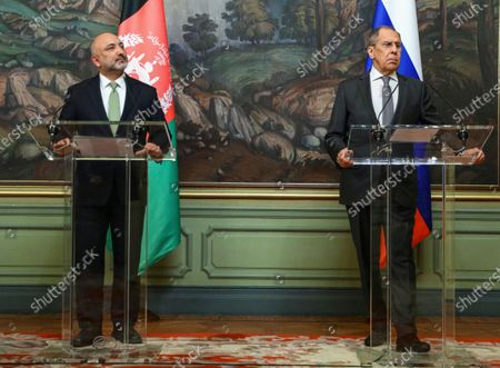 Stock Image of Russian Foreign Minister Sergei Lavrov (R) and Afghanistan's Foreign Minister Mohammad Hanif Atmar (L) attend a press conference during their meeting in Moscow, Russia, 26 February 2021.