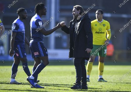 Daniel Farke manager of Norwich City and Anthony Stewart of Wycombe Wanderers at full time
