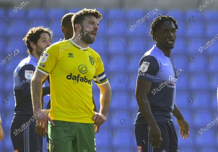Grant Hanley of Norwich City and Anthony Stewart of Wycombe Wanderers