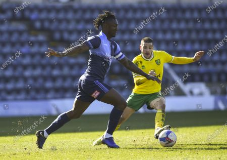 Anthony Stewart of Wycombe Wanderers under pressure from Emi Buendía of Norwich City
