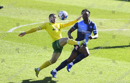 Emi Buendía of Norwich City under pressure from Anthony Stewart of Wycombe Wanderers
