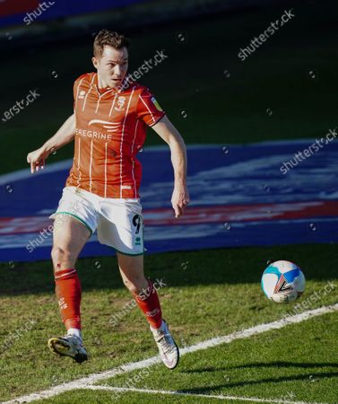 Tom Hopper of Lincoln City keeps the ball in play