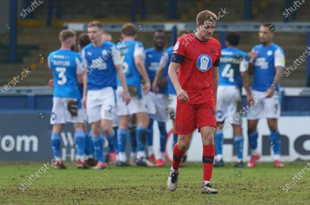 Scott Wootton of Wigan Athletic (14) looks dejected after the goal by Jonson Clarke-Harris of Peterborough United (9)