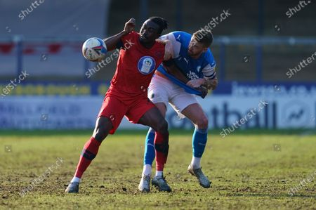 Joe Dodoo of Wigan Athletic (20) and Mark Beevers of Peterborough United (5)