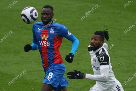 André-Frank Zambo Anguissa of Fulham (29) and Cheikhou Kouyate of Crystal Palace (8)