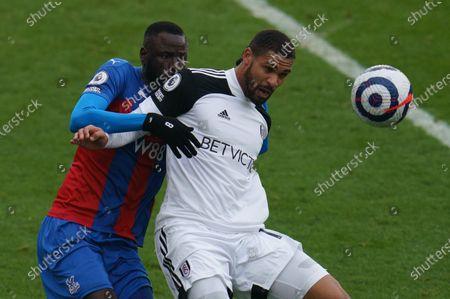 Cheikhou Kouyate of Crystal Palace (8) and Ruben Loftus-Cheek of Fulham (15)