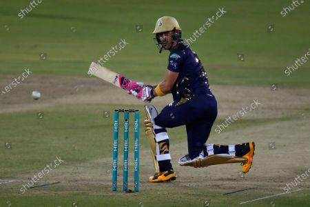 Quetta Gladiators' Faf du Plessis plays a shot during a Pakistan Super League T20 cricket match between Quetta Gladiators and Peshawar Zalmi at the National Stadium, in Karachi, Pakistan