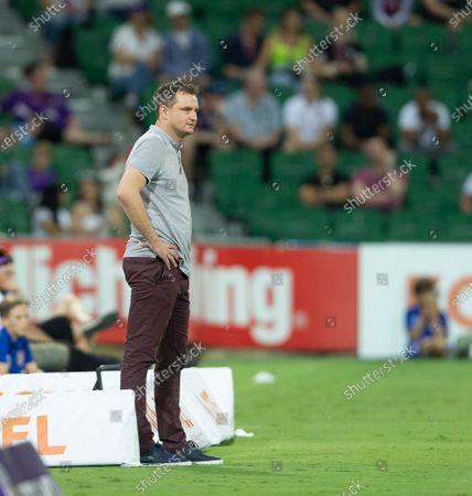 Warren Moon head coach of Brisbane Roar watches play during the second half; HBF Park, Perth, Western Australia, Australia; A League Football, Perth Glory versus Brisbane Roar.