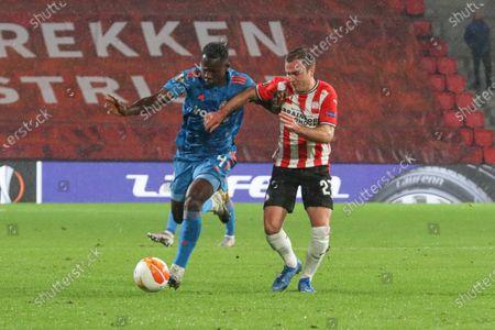 Stock Photo of (L-R) Mady Camara #4 of Olympiacos, Mario Götze #27 of PSV