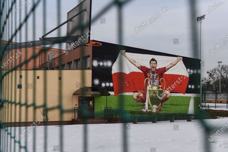 A huge mural featuring player of the Polish national soccerl team Robert Lewandowski is painted on the wall of an elementary school in Chelm, eastern Poland, 26 February 2021. Robert Lewandowski plays as a striker for German Bundesliga club Bayern Munich and is the captain of the Polish national team.