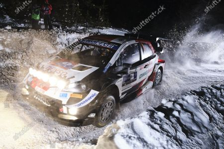 Sebastien Ogier of France and his co-driver Julien Ingrassia of France steer their Toyota Yaris WRC car during the second stage of the FIA WRC Arctic Lapland Rally in Rovaniemi, Finnish Lapland, on February 26, 2021.