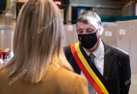 Defence minister Ludivine Dedonder and Tournai acting mayor Paul-Olivier Delannois pictured wearing a mouth mask during the visit of Defence Minister to the militaries who help for the COVID-19 vaccination campaign 1A4 in Wallonia, which concerns 120.000 persons including general practitioners, nurses, dentists, family support workers and more, Friday 26 February 2021 at the sport hall of Tournai, transformed in a vaccination center.