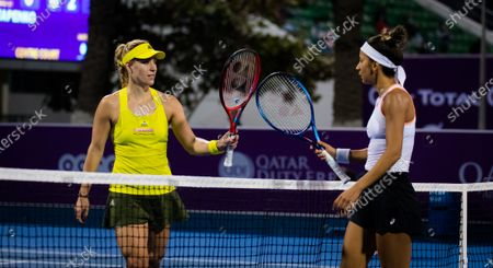 Angelique Kerber of Germany & Cagla Buyukakcay of Turkey in action during her first round match at the 2021 Qatar Total Open WTA 500 tournament