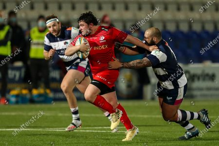 Sam Crean of Saracens is tackled by Kai Owen of Coventry Rugby (on loan from Worcester Warriors)