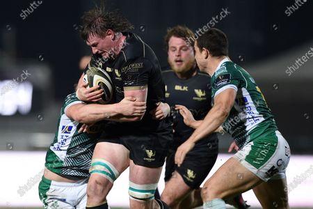 Stock Picture of Benetton Rugby vs Connacht. Connacht's Gavin Thornbury tackled by Leonardo Sarto of Benetton