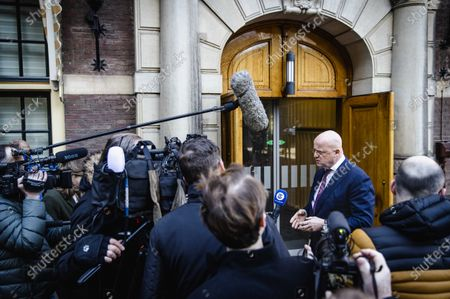 Outgoing Dutch Minister of Justice and Security Ferdinand Grapperhaus (R) speaks to the press at the Binnenhof prior to a meeting between the Ministerial Committee COVID-19 and the Council of Ministers in The Hague, the Netherlands, 26 February 2021.
