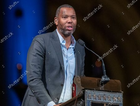 """Author Ta-Nehisi Coates speaks during the Celebration of the Life of Toni Morrison in New York on . Coates, the acclaimed essayist and novelist who expanded the world of Wakanda in Marvel comics, will write the script for a new """"Superman"""" film from Warner Bros. The studio announced Friday that Coates will pen the screenplay for an upcoming """"Superman"""" film that's early in development"""