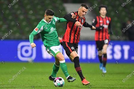 Stock Photo of Milot Rashica (L) of Bremen in action against Filip Kostic (R) of Frankfurt during the German Bundesliga soccer match between Werder Bremen and Eintracht Frankfurt in Bremen, Germany, 26 February 2021.