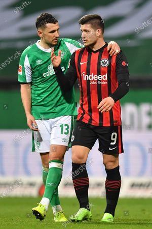 Milos Veljkovic (L) of Bremen and Luka Jovic (R) of Frankfurt react after the German Bundesliga soccer match between Werder Bremen and Eintracht Frankfurt in Bremen, Germany, 26 February 2021.