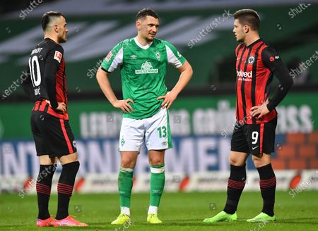 Milos Veljkovic (C) of Bremen and Frankfurt players Filip Kostic (L) and Luka Jovic (R), all from Serbia, react after the German Bundesliga soccer match between Werder Bremen and Eintracht Frankfurt in Bremen, Germany, 26 February 2021.