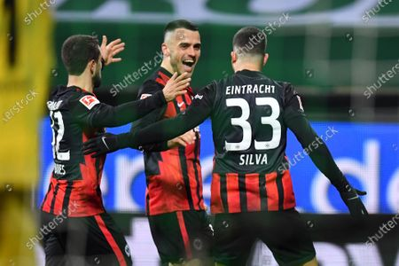 Andre Silva (R) of Frankfurt celebrates with teammates Amin Younes (L) and Filip Kostic (C) after scoring the 1-0 lead during the German Bundesliga soccer match between Werder Bremen and Eintracht Frankfurt in Bremen, Germany, 26 February 2021.