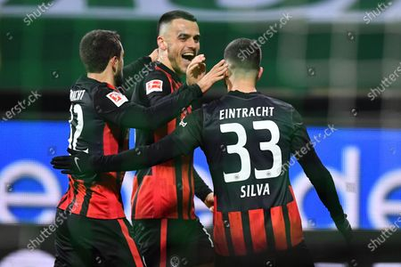 Stock Image of Andre Silva (R) of Frankfurt celebrates with teammates Amin Younes (L) and Filip Kostic (C) after scoring the 1-0 lead during the German Bundesliga soccer match between Werder Bremen and Eintracht Frankfurt in Bremen, Germany, 26 February 2021.
