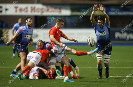 Rory Thornton of Cardiff Blues looks to charge down the kick from Nick McCarthy of Munster