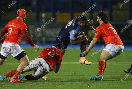Rey Lee-Lo of Cardiff Blues takes on Kevin O'Byrne of Munster and Jack O'Sullivan of Munster