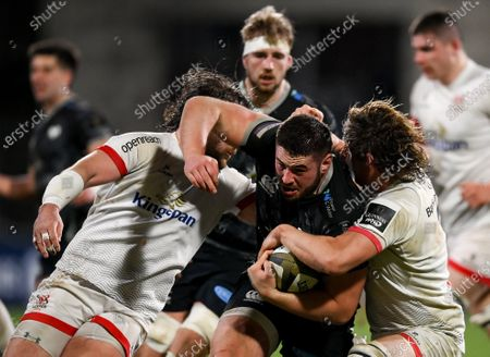Stock Picture of Gareth Thomas of Ospreys in action against John Andrew, left, and Jordi Murphy of Ulster