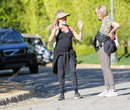 Goldie Hawn keeps the sun out of her eyes as she wears a visor on her hike