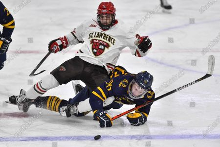 St. Lawrence forward Jordan Steinmetz (29) is tripped up by Quinnipiac forward Ty Smilanic (96) during the second period of an NCAA hockey game on in Canton, N.Y