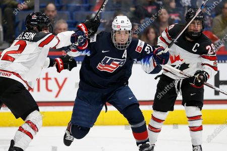 Stock Photo of Canada's Meaghan Mikkelson (12) and Marie-Philip Poulin (29) defends against United States' Hilary Knight (21) during the third period of a rivalry series women's hockey game in Hartford, Conn. Knight has played in rinks large and small spanning globe during her 14 years representing USA Hockey. That does not prevent the three-time Olympian from getting chills in anticipation of hitting the ice for the first time at Madison Square Garden, for the opening stop of the Professional Women's Hockey Players' Association Dream Gap Tour's second season
