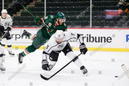 Minnesota Wild right wing Ryan Hartman (38) is cut off from the puck by Los Angeles Kings defenseman Drew Doughty (8) in the first period during an NHL hockey game, in St. Paul, Minn
