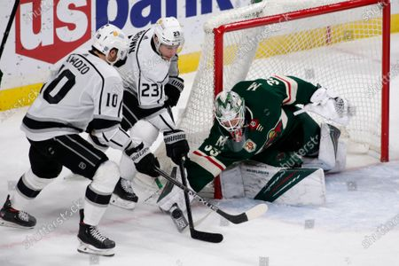 Minnesota Wild goalie Cam Talbot (33) stops a shot by Los Angeles Kings center Michael Amadio (10) and right wing Dustin Brown (23) in the third period during an NHL hockey game, in St. Paul, Minn