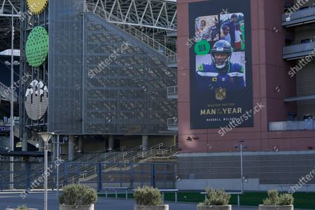 Banner commemorating Seattle Seahawks quarterback Russell Wilson being named NFL football's Man of the Year, is shown, at Lumen Field in Seattle, where the NFL football team plays all of their home games